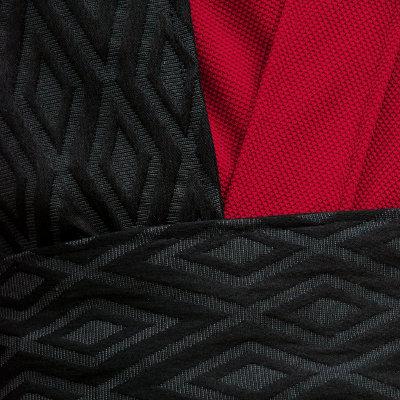 Black Diamond Textured Reversible Surcoat with Red Knitwear Textured Scrunched Sleeve Tunic Detail