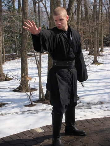 Christopher in his black cotton Sith ensemble